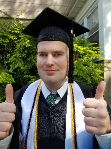 NJCU Grad Jon Gabry giving two thumbs up!